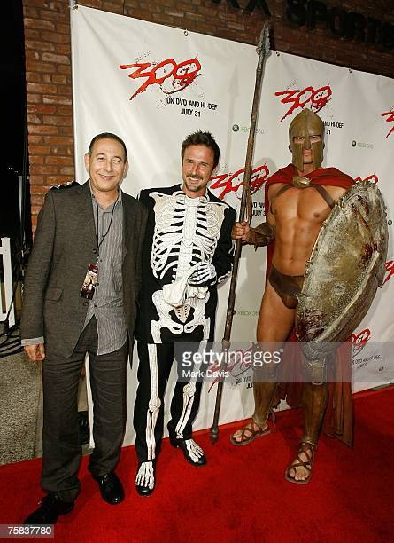 Actors Paul Reubens and David Arquette pose for photographers at the DVD release party for the '300' held at Petco Park Stadium on July 272007 in...