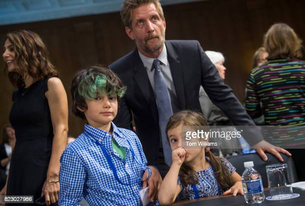 Actors Paul Sparks and Annie Parisse left and their children Emmett and Lydia attend a Senate Aging Committee hearing in Dirksen Building to urge...