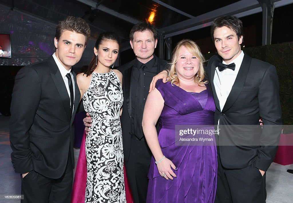 Actors <a gi-track='captionPersonalityLinkClicked' href=/galleries/search?phrase=Paul+Wesley&family=editorial&specificpeople=693176 ng-click='$event.stopPropagation()'>Paul Wesley</a> and <a gi-track='captionPersonalityLinkClicked' href=/galleries/search?phrase=Nina+Dobrev&family=editorial&specificpeople=4397485 ng-click='$event.stopPropagation()'>Nina Dobrev</a>, Director <a gi-track='captionPersonalityLinkClicked' href=/galleries/search?phrase=Kevin+Williamson&family=editorial&specificpeople=631337 ng-click='$event.stopPropagation()'>Kevin Williamson</a>, writer Julie Plec and actor <a gi-track='captionPersonalityLinkClicked' href=/galleries/search?phrase=Ian+Somerhalder&family=editorial&specificpeople=614226 ng-click='$event.stopPropagation()'>Ian Somerhalder</a> attend Grey Goose at 21st Annual Elton John AIDS Foundation Academy Awards Viewing Party at West Hollywood Park on February 24, 2013 in West Hollywood, California.