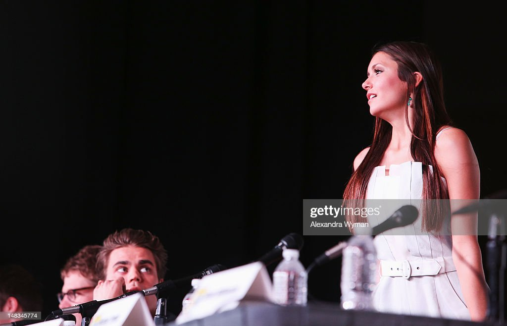 Actors <a gi-track='captionPersonalityLinkClicked' href=/galleries/search?phrase=Paul+Wesley&family=editorial&specificpeople=693176 ng-click='$event.stopPropagation()'>Paul Wesley</a> (L) and <a gi-track='captionPersonalityLinkClicked' href=/galleries/search?phrase=Nina+Dobrev&family=editorial&specificpeople=4397485 ng-click='$event.stopPropagation()'>Nina Dobrev</a> speak at 'The Vampire Diaries' screening during Comic-Con International 2012 at San Diego Convention Center on July 14, 2012 in San Diego, California.