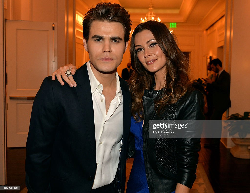 Actors <a gi-track='captionPersonalityLinkClicked' href=/galleries/search?phrase=Paul+Wesley&family=editorial&specificpeople=693176 ng-click='$event.stopPropagation()'>Paul Wesley</a> and <a gi-track='captionPersonalityLinkClicked' href=/galleries/search?phrase=Olga+Fonda&family=editorial&specificpeople=3989453 ng-click='$event.stopPropagation()'>Olga Fonda</a> attend The Vampire Diaries 100th Episode Celebration on November 9, 2013 in Atlanta, Georgia.