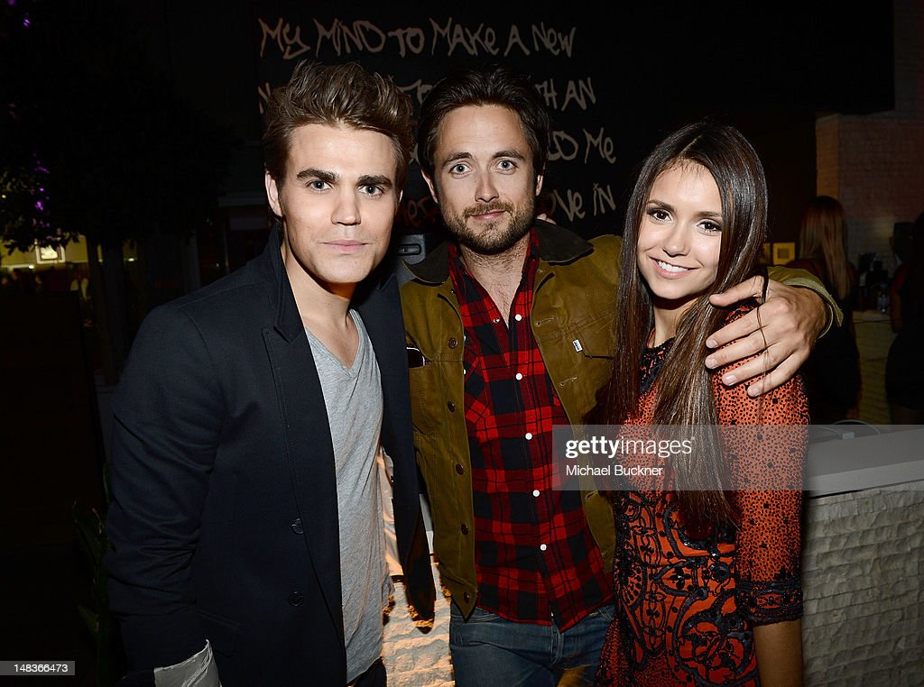 Actors <a gi-track='captionPersonalityLinkClicked' href=/galleries/search?phrase=Paul+Wesley&family=editorial&specificpeople=693176 ng-click='$event.stopPropagation()'>Paul Wesley</a>, <a gi-track='captionPersonalityLinkClicked' href=/galleries/search?phrase=Justin+Chatwin&family=editorial&specificpeople=560431 ng-click='$event.stopPropagation()'>Justin Chatwin</a> and <a gi-track='captionPersonalityLinkClicked' href=/galleries/search?phrase=Nina+Dobrev&family=editorial&specificpeople=4397485 ng-click='$event.stopPropagation()'>Nina Dobrev</a> attend Entertainment Weekly's 6th Annual Comic-Con Celebration sponsored by Just Dance 4 held at the Hard Rock Hotel San Diego on July 14, 2012 in San Diego, California.