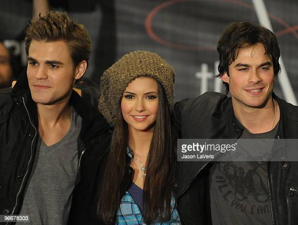 Actors Paul Wesley Nina Dobrev and Ian Somerhalder attend 'The Vampire Diaries' Hot Topic tour at Hot Topic on February 13 2010 in Canoga Park...