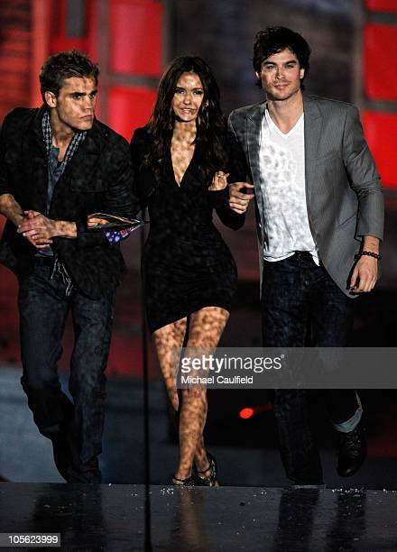Actors Paul Wesley Nina Dobrev and Ian Somerhalder present the award for Best Horror Actress onstage during Spike TV's 'Scream 2010' at The Greek...
