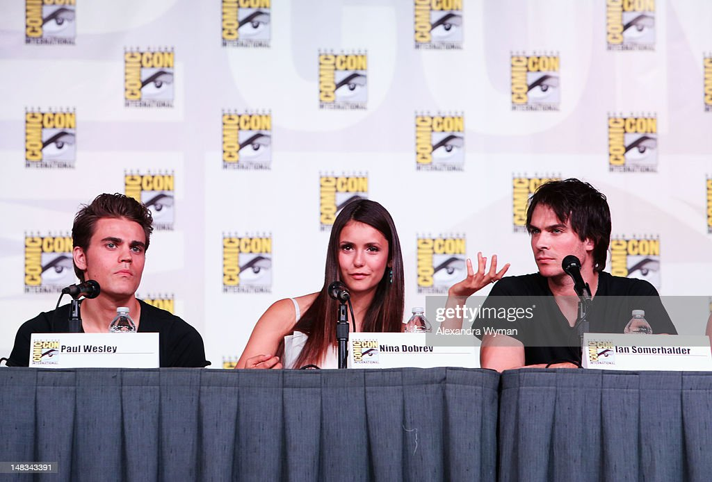 Actors <a gi-track='captionPersonalityLinkClicked' href=/galleries/search?phrase=Paul+Wesley&family=editorial&specificpeople=693176 ng-click='$event.stopPropagation()'>Paul Wesley</a>, <a gi-track='captionPersonalityLinkClicked' href=/galleries/search?phrase=Nina+Dobrev&family=editorial&specificpeople=4397485 ng-click='$event.stopPropagation()'>Nina Dobrev</a>, and <a gi-track='captionPersonalityLinkClicked' href=/galleries/search?phrase=Ian+Somerhalder&family=editorial&specificpeople=614226 ng-click='$event.stopPropagation()'>Ian Somerhalder</a> speak at 'The Vampire Diaries' screening during Comic-Con International 2012 at San Diego Convention Center on July 14, 2012 in San Diego, California.