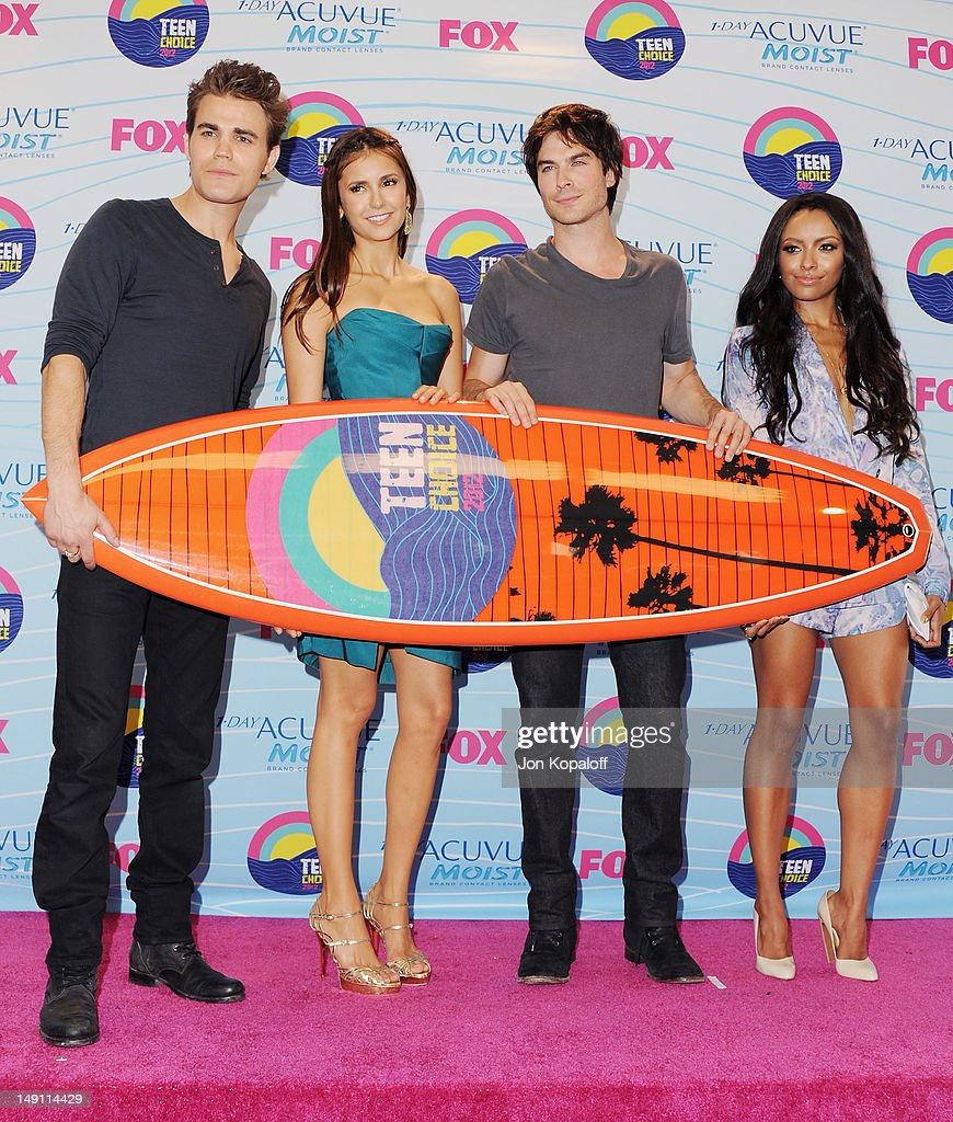 Actors <a gi-track='captionPersonalityLinkClicked' href=/galleries/search?phrase=Paul+Wesley&family=editorial&specificpeople=693176 ng-click='$event.stopPropagation()'>Paul Wesley</a>, <a gi-track='captionPersonalityLinkClicked' href=/galleries/search?phrase=Nina+Dobrev&family=editorial&specificpeople=4397485 ng-click='$event.stopPropagation()'>Nina Dobrev</a>, <a gi-track='captionPersonalityLinkClicked' href=/galleries/search?phrase=Ian+Somerhalder&family=editorial&specificpeople=614226 ng-click='$event.stopPropagation()'>Ian Somerhalder</a> and Kat Graham of The Vampire Diaries pose in the press room at the 2012 Teen Choice Awards at Gibson Amphitheatre on July 22, 2012 in Universal City, California.