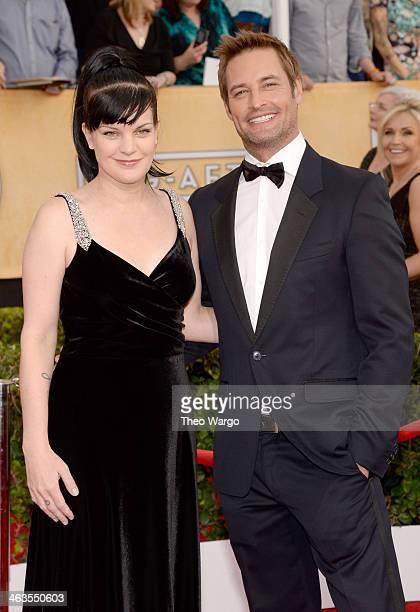 Actors Pauley Perrette and Josh Holloway attend 20th Annual Screen Actors Guild Awards at The Shrine Auditorium on January 18 2014 in Los Angeles...