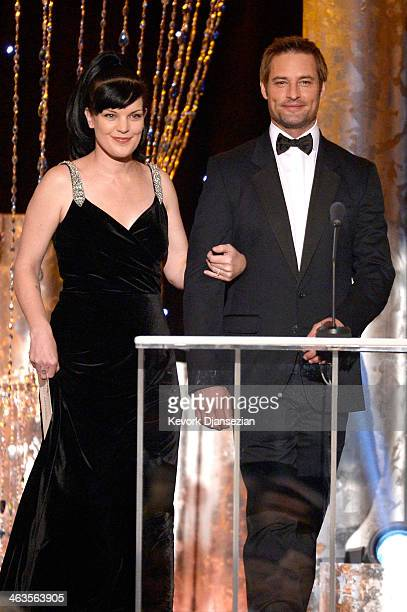 Actors Pauley Perrette and Josh Holloway walk onstage during the 20th Annual Screen Actors Guild Awards at The Shrine Auditorium on January 18 2014...