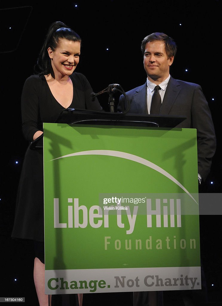 Actors Pauley Perrette and Michael Weatherly present the Creative Vision Award during Liberty Hill's Upton Sinclair Awards Dinner Honors - Show at The Beverly Hilton Hotel on April 23, 2013 in Beverly Hills, California.