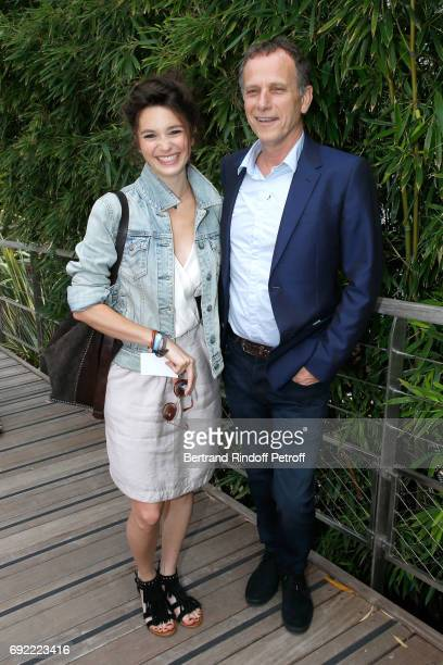 Actors Pauline Cheviller and Charles Berling attend the 2017 French Tennis Open Day Height at Roland Garros on June 4 2017 in Paris France