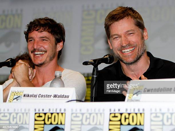 Actors Pedro Pascal and Nikolaj CosterWaldau attend HBO's 'Game of Thrones' Panel during ComicCon 2014 on July 25 2014 in San Diego California