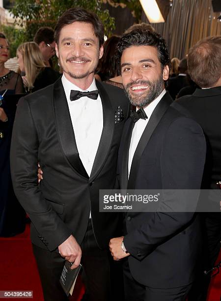 Actors Pedro Pascal and Oscar Isaac attends the 73rd Annual Golden Globe Awards held at the Beverly Hilton Hotel on January 10 2016 in Beverly Hills...