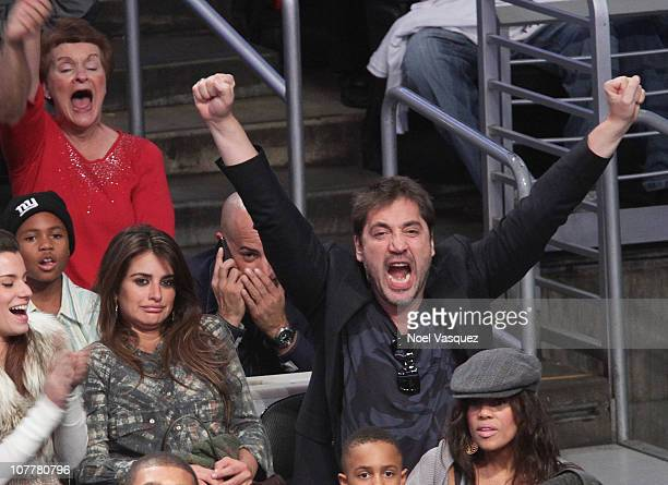 Actors Penelope Cruz and Javier Bardem attend a game between the Miami Heat and the Los Angeles Lakers at Staples Center on December 25 2010 in Los...