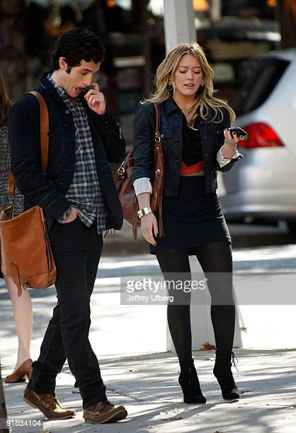 Actors Penn Badgley and Hilary Duff is seen on location for 'Gossip Girl' on the streets of Manhattan on October 6 2009 in New York City