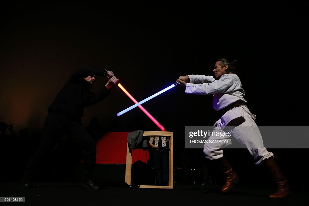 Actors perform a lightsaber fight during the 'Darth Vader's trial' event at the Grand Rex movie theatre in Paris on December 14 two days ahead of the...