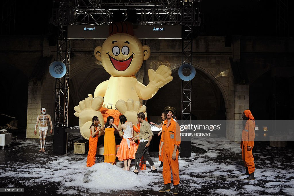 Actors perform a play written and directed Belgian Jan Lauwers 'Place du marché 76' on July 7, 2013 in Avignon, during the 67th International Theatre festival. AFP PHOTO / BORIS HORVAT
