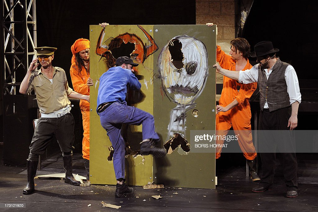 Actors perform a play written and directed Belgian Jan Lauwers 'Place du marché 76' on July 7, 2013 in Avignon, during the 67th International Theatre festival.