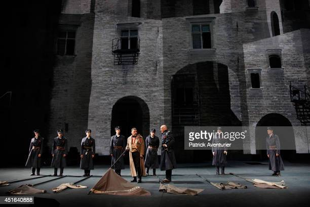 Actors perform a scene from 'Le Prince de Hombourg' as part of the 68th International Theatre Festival at Palais des Papes on July 2 2014 in Avignon...