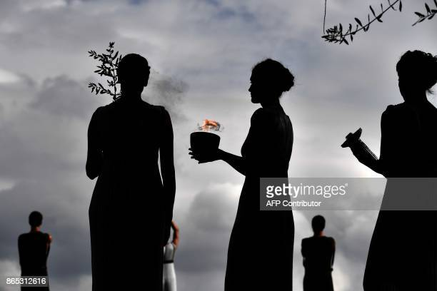 TOPSHOT Actors perform at the Temple of Hera on October 23 2017 during a dressed rehearsal of the lighting ceremony of the Olympic flame in ancient...
