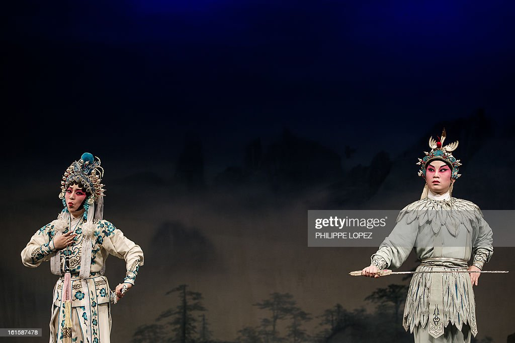 Actors perform during a Cantonese Opera in Hong Kong on February 12, 2013 as part of the Chinese New Year celebrations held in the city. Other than its southern dialect, Cantonese opera differs from mainland operatic traditions in its use of percussion instruments like gongs and cymbals. Actors wear elaborate costumes and make-up, and must be adept at elaborately choreographed martial arts as well as singing. AFP PHOTO / Philippe Lopez