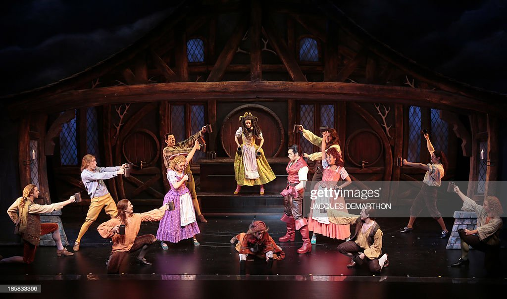 Actors perform during a dress rehearsal of 'the Beauty and the Beast : The Broadway Musical' (La Belle et la Bete) at the Mogador theater in Paris on October 24, 2013.