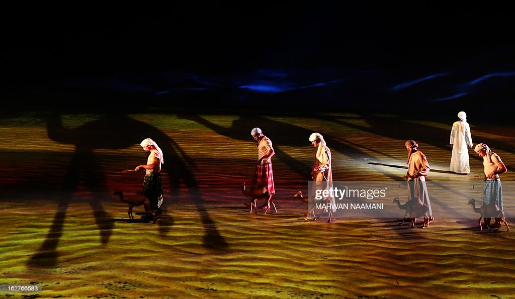 Actors perform in the preview of the theatrical show 'Story of a Fort, Legacy of a Nation' in Abu Dhabi on February 26, 2013. The show, directed by Italian Franco Dragone, tells the tale of a young Emirati boy who walks by Qasr Al-Hosn (Fort Palace) when suddenly a majestic falcon appears to tell the boy the story of the fort through a visual and musical poem. Through the boys journey the play explores the fundamental values and the historical characters that forged the identity of the United Arab Emirates.