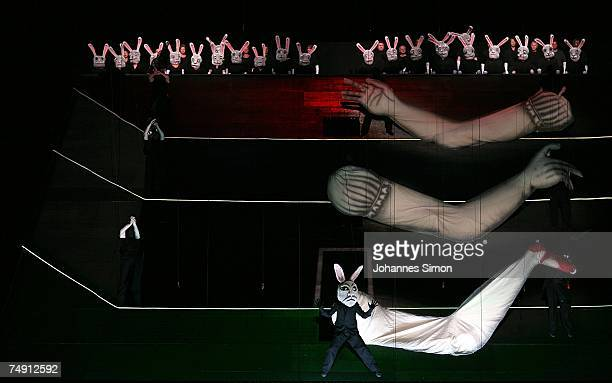 Actors perform on stage during the rehearsal of the opera 'Alice in Wonderland' by the Korean composer Unsuk Chin at the Munich Opera house...