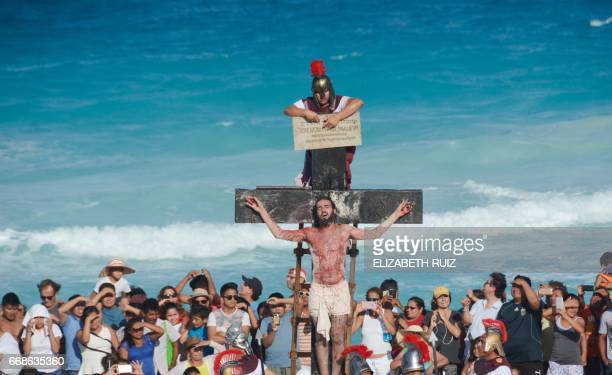 Actors perform the Passion of Jesus Christ during the Good Friday's procession at the Cancun resort Quintana Roo State Mexico on April 14 2017 The...