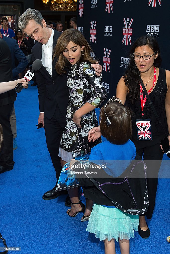 Actors <a gi-track='captionPersonalityLinkClicked' href=/galleries/search?phrase=Peter+Capaldi&family=editorial&specificpeople=639349 ng-click='$event.stopPropagation()'>Peter Capaldi</a> and Jenna Coleman with young fan at BBC America's 'Doctor Who' Premiere Fan Screening at Ziegfeld Theater on August 14, 2014 in New York City.