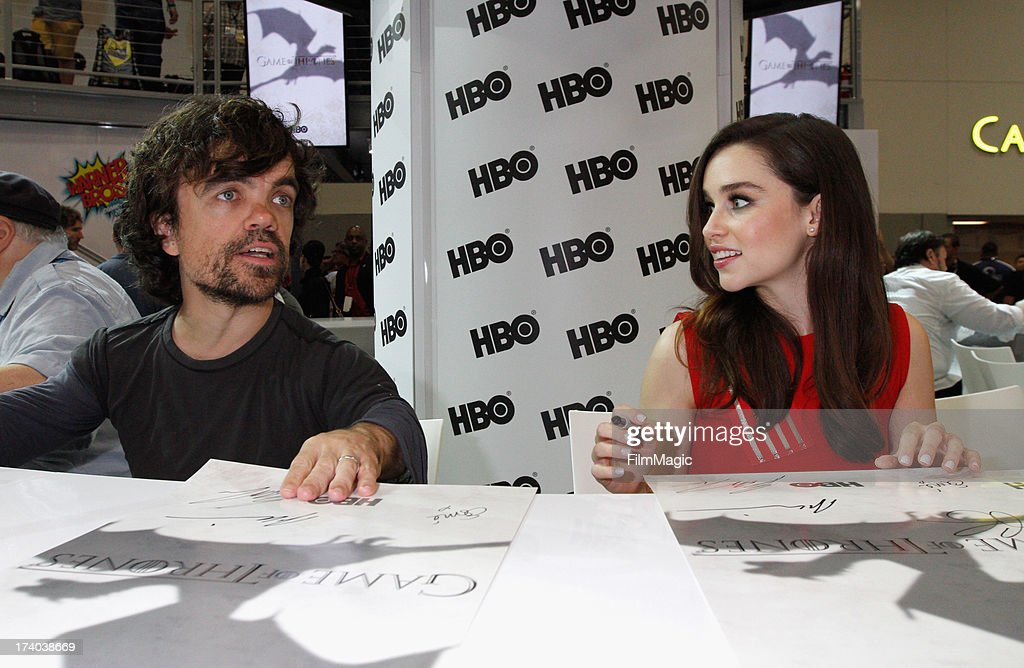 Actors Peter Dinklage and Emilia Clarke attend HBO's 'Game Of Thrones' cast autograph signing at San Diego Convention Center on July 19, 2013 in San Diego, California.