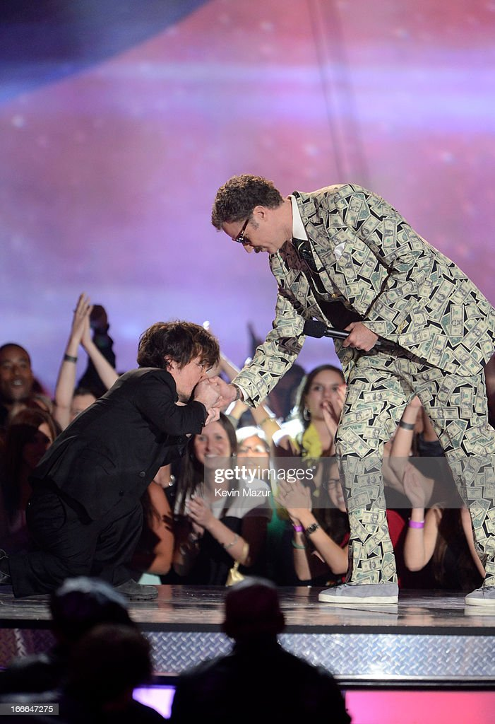 Actors Peter Dinklage (L) and Will Ferrell speak onstage during the 2013 MTV Movie Awards at Sony Pictures Studios on April 14, 2013 in Culver City, California.