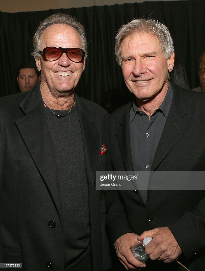 Actors <a gi-track='captionPersonalityLinkClicked' href=/galleries/search?phrase=Peter+Fonda&family=editorial&specificpeople=213498 ng-click='$event.stopPropagation()'>Peter Fonda</a> and <a gi-track='captionPersonalityLinkClicked' href=/galleries/search?phrase=Harrison+Ford+-+Ator+-+Nascido+em+1942&family=editorial&specificpeople=11508906 ng-click='$event.stopPropagation()'>Harrison Ford</a> attend Target Presents AFI's Night at the Movies at ArcLight Cinemas on April 24, 2013 in Hollywood, California.