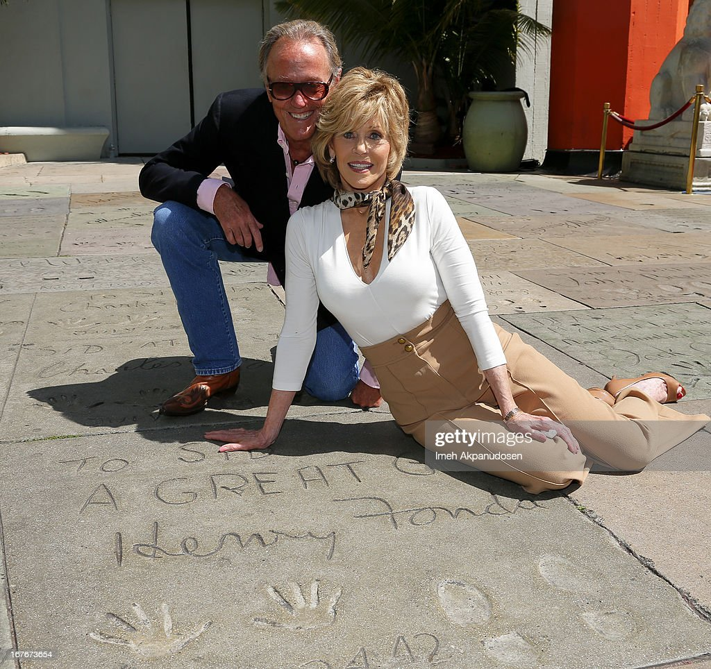 Actors Peter Fonda (L) and Jane Fonda attend Jane Fonda's hand and footprint ceremony at TCL Chinese Theatre on April 27, 2013 in Hollywood, California.