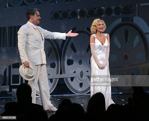 Actors Peter Gallagher and Kristin Chenoweth take a bow during curtain call for the opening night performance of 'On The Twentieth Century' at...