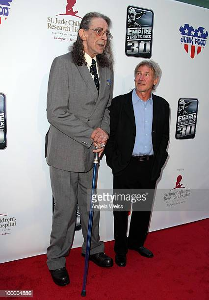 Actors Peter Mayhew and Harrison Ford arrive to St Jude's 30th anniversary screening of 'The Empire Strikes Back' at Arclight Cinema on May 19 2010...
