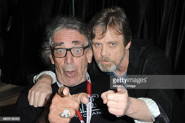 Actors Peter Mayhew and Mark Hamill pose backstage at the Lucasfilm panel during ComicCon International 2015 at the San Diego Convention Center on...
