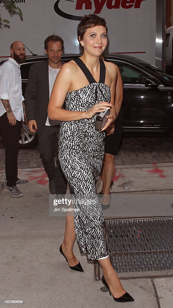 Actors Peter Sarsgaard and Maggie Gyllenhaal attend the Cinema Society Screening Of 'The Honorable Woman' at Crosby Street Hotel on July 23, 2014 in New York City.