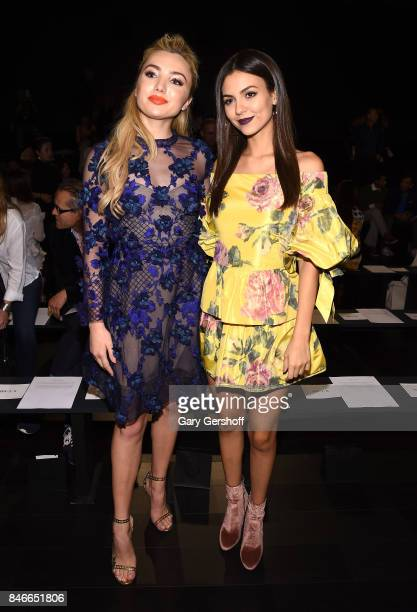 Actors Peyton List and Victoria Justice attend the Marchesa fashion show during New York Fashion Week at Gallery 1 Skylight Clarkson Sq on September...