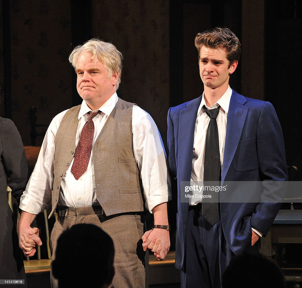 Actors Philip Seymour Hoffman and Andrew Garfield take a curtain call at the Broadway opening night of 'Death Of A Salesman' at the Barrymore Theatre...