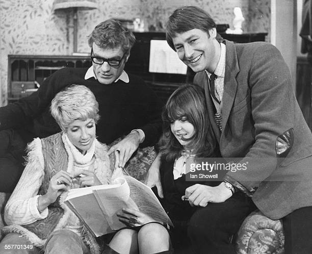 Actors Philip Voss Justine Lord Chrissie Shrimpton and Timothy Parkes going over the script during rehearsals for the play 'The Flip Side' at the New...