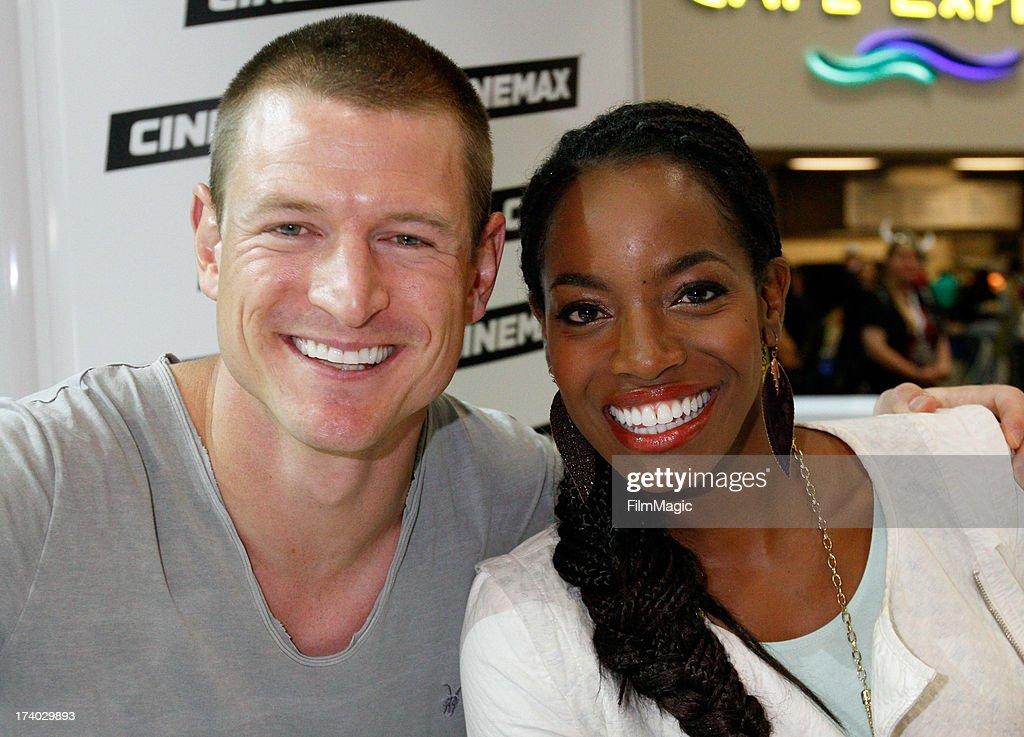 Actors Philip Winchester (L) and Milauna Jackson attend Cinemax's 'Strike Back' cast autograph signing at San Diego Convention Center on July 19, 2013 in San Diego, California.