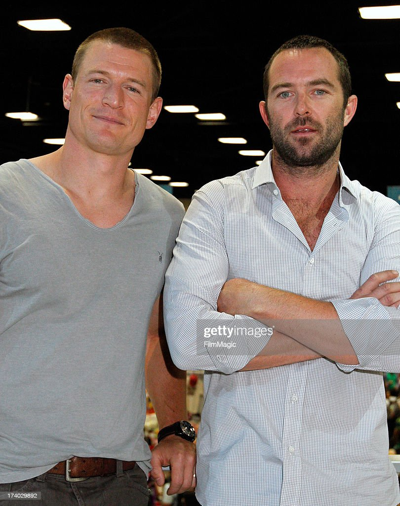 Actors Philip Winchester (L) and Sullivan Stapleton attend Cinemax's 'Strike Back' cast autograph signing at San Diego Convention Center on July 19, 2013 in San Diego, California.