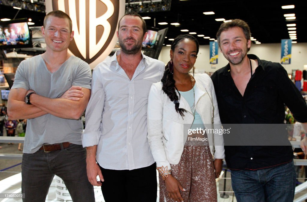 Actors Philip Winchester, Sullivan Stapleton and Milauna Jackson and director Michael J. Bassett attend Cinemax's 'Strike Back' cast autograph signing at San Diego Convention Center on July 19, 2013 in San Diego, California.
