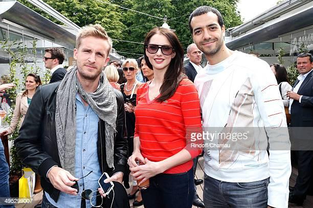 Actors Philippe Lacheau alias Fifi Frederique Bel and Tarek Boudali attend the Roland Garros French Tennis Open 2014 Day 9 on June 2 2014 in Paris...