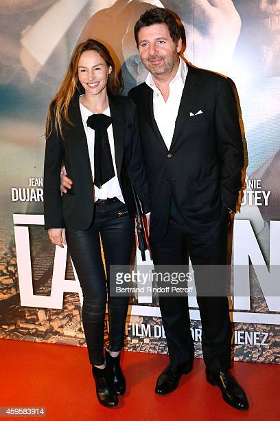 Actors Philippe Lellouche with his wife Vanessa Demouy attend the 'La French' Paris Premiere Held at Cinema Gaumont Capucine on November 25 2014 in...