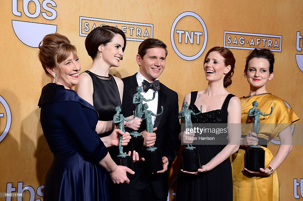 Actors Phyllis Logan, <a gi-track='captionPersonalityLinkClicked' href=/galleries/search?phrase=Michelle+Dockery&family=editorial&specificpeople=4047702 ng-click='$event.stopPropagation()'>Michelle Dockery</a>, <a gi-track='captionPersonalityLinkClicked' href=/galleries/search?phrase=Allen+Leech&family=editorial&specificpeople=2167022 ng-click='$event.stopPropagation()'>Allen Leech</a>, <a gi-track='captionPersonalityLinkClicked' href=/galleries/search?phrase=Amy+Nuttall&family=editorial&specificpeople=211471 ng-click='$event.stopPropagation()'>Amy Nuttall</a> and <a gi-track='captionPersonalityLinkClicked' href=/galleries/search?phrase=Sophie+McShera&family=editorial&specificpeople=7829938 ng-click='$event.stopPropagation()'>Sophie McShera</a>, winners of Outstanding Performance by an Ensemble in a Drama Series for 'Downton Abbey,' pose in the press room during the 19th Annual Screen Actors Guild Awards held at The Shrine Auditorium on January 27, 2013 in Los Angeles, California.