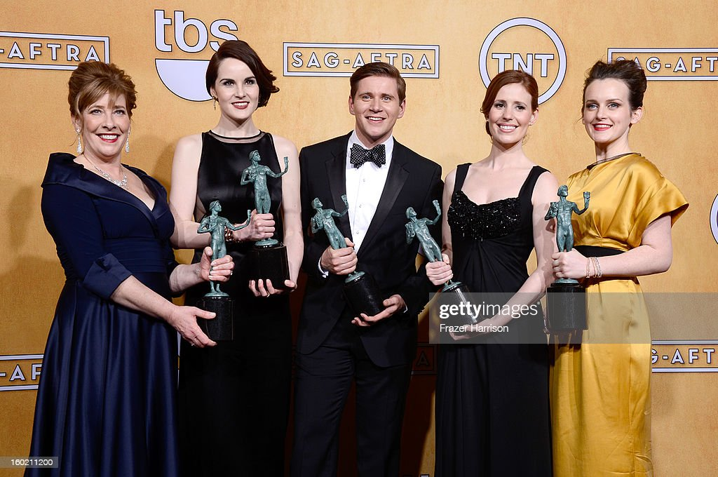 Actors Phyllis Logan, Michelle Dockery, Allen Leech, Amy Nuttall and Sophie McShera, winners of Outstanding Performance by an Ensemble in a Drama Series for 'Downton Abbey,' pose in the press room during the 19th Annual Screen Actors Guild Awards held at The Shrine Auditorium on January 27, 2013 in Los Angeles, California.