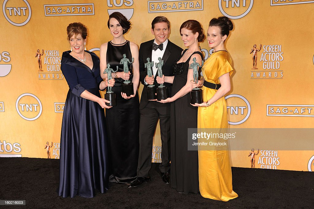 Actors Phyllis Logan, <a gi-track='captionPersonalityLinkClicked' href=/galleries/search?phrase=Michelle+Dockery&family=editorial&specificpeople=4047702 ng-click='$event.stopPropagation()'>Michelle Dockery</a>, <a gi-track='captionPersonalityLinkClicked' href=/galleries/search?phrase=Allen+Leech&family=editorial&specificpeople=2167022 ng-click='$event.stopPropagation()'>Allen Leech</a>, <a gi-track='captionPersonalityLinkClicked' href=/galleries/search?phrase=Amy+Nuttall&family=editorial&specificpeople=211471 ng-click='$event.stopPropagation()'>Amy Nuttall</a> and Sophie McShera, winners of Outstanding Performance by an Ensemble in a Drama Series for 'Downton Abbey,' pose in the press room during the 19th Annual Screen Actors Guild Awards at The Shrine Auditorium on January 27, 2013 in Los Angeles, California.