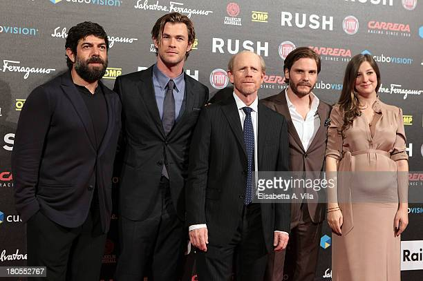 Actors Pierfrancesco Favino Chris Hemsworth director Ron Howard actor Daniel Bruhl and actress Alexandra Maria Lara attend the 'Rush' premiere at...