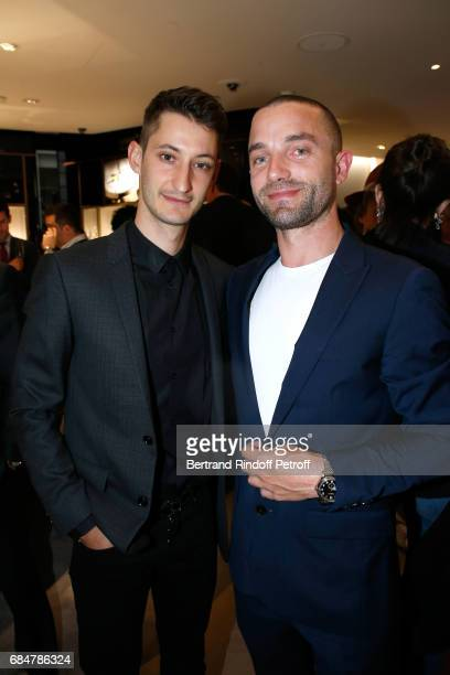 Actors Pierre Niney and Guillaume Gouix attend the Montblanc ChampsElysees Flagship Reopening on May 18 2017 in Paris France